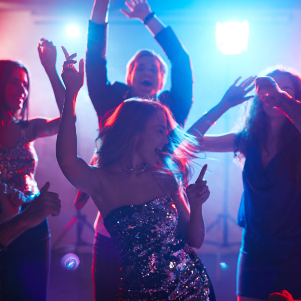 Ecstatic friends enjoying party with dancing